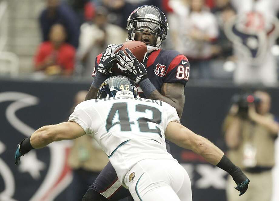 Andre Johnson cradles the ball in the first quarter for one of his 14 receptions for 273 yards. Photo: Patric Schneider, Associated Press