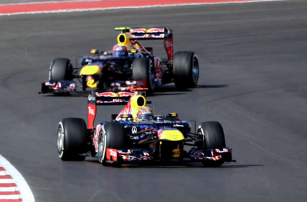 Red Bull driver Sebastian Vettel, of Germany, leads his teammate Red Bull driver Mark Webber, of Australia, into a turn during the Formula One U.S. Grand Prix auto race at the Circuit of the Americas Sunday, Nov. 18, 2012, in Austin, Texas. (AP Photo/David J. Phillip) Photo: David J. Phillip, Associated Press / AP
