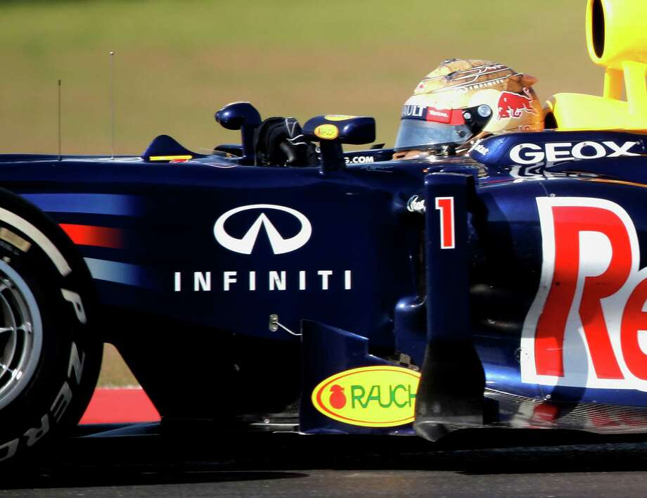 Red Bull driver Sebastian Vettel, of Germany, steers his car the Formula One U.S. Grand Prix auto race at the Circuit of the Americas Sunday, Nov. 18, 2012, in Austin, Texas. (AP Photo/David J. Phillip) Photo: David J. Phillip, Associated Press / AP