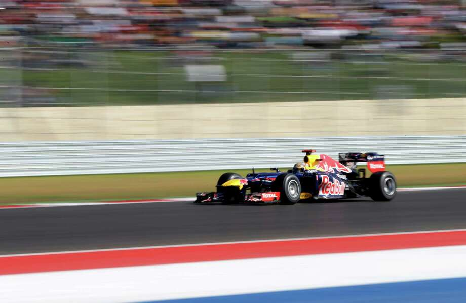 Red Bull driver Sebastian Vettel, of Germany, steers his car during the Formula One U.S. Grand Prix auto race at the Circuit of the Americas Sunday, Nov. 18, 2012, in Austin, Texas. McLaren Mercedes driver Lewis Hamilton of Britain won the race and Vettel finished second. (AP Photo/David J. Phillip) Photo: David J. Phillip, Associated Press / AP