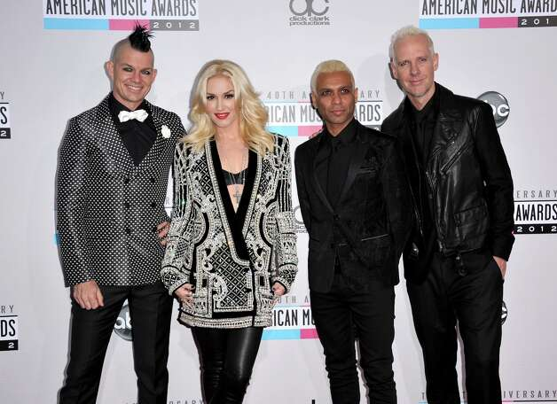 Musical group No Doubt, from left, Adrian Young, Gwen Stefani, Tony Kanal and Tom Dumont arrive at the 40th Anniversary American Music Awards on Sunday, Nov. 18, 2012, in Los Angeles. (Photo by Jordan Strauss/Invision/AP) Photo: Jordan Strauss, Associated Press / Invision