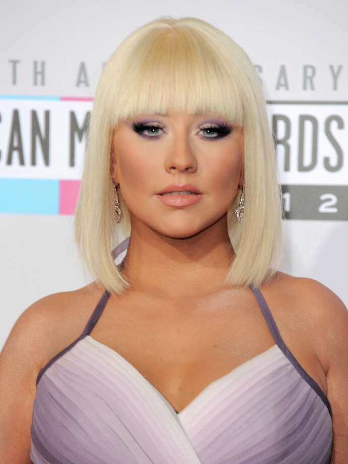 Christina Aguilera arrives at the 40th Anniversary American Music Awards on Sunday, Nov. 18, 2012, in Los Angeles. (Photo by Jordan Strauss/Invision/AP) Photo: Jordan Strauss, Associated Press / Invision