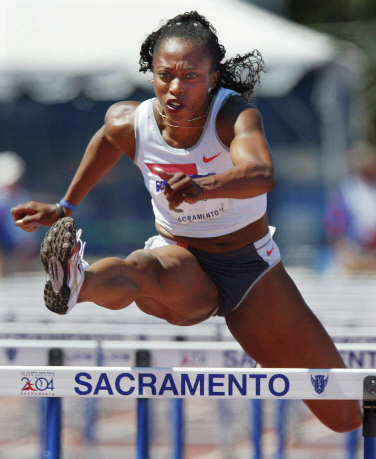Two-time Olympic 100 meter champion and 3-time World 100-meter hurdles champion Gail Devers clears a hurdle during the women's 110-meter semifinals at the U.S. Olympic track and field trials in Sacramento, Calif., Sunday, July 18, 2004. Devers was second in her heat with a time of 12.70.  (AP Photo/Rusty Kennedy) Photo: RUSTY KENNEDY / AP