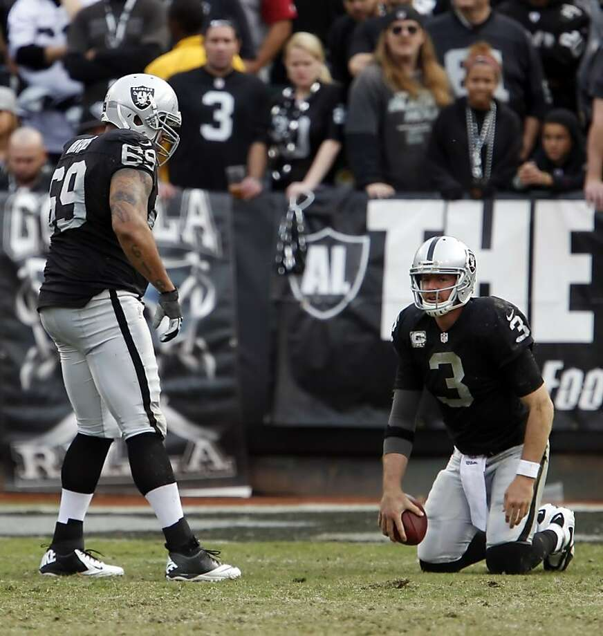 "Carson Palmer said, ""Right now, we're shooting for 9-7,"" but the reality is the Raiders once again have been brought to their knees, and a third straight 8-8 season seems unlikely. Photo: Carlos Avila Gonzalez, The Chronicle"