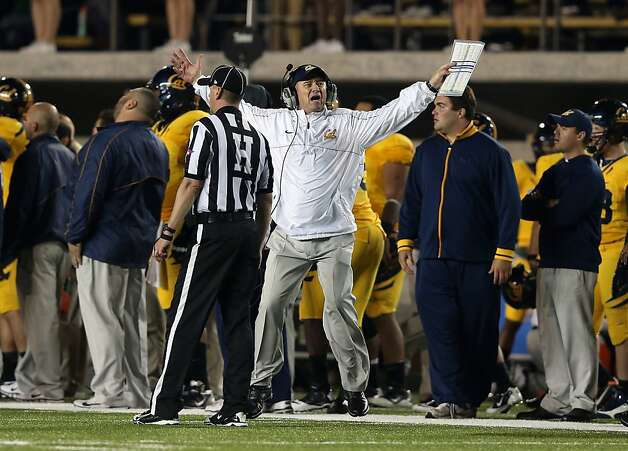 Jeff Tedford (center) had his worst season in 11 years as Cal's head coach, ending with five straight losses, the last two by a combined score of 121-31. Photo: Ezra Shaw, Getty Images