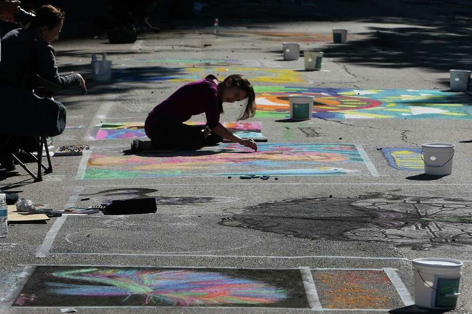 Natalia Rodriguez works on her chalk art piece Sunday during the Via Colori art festival in downtown. Photo: James Nielsen, Staff / © Houston Chronicle 2012