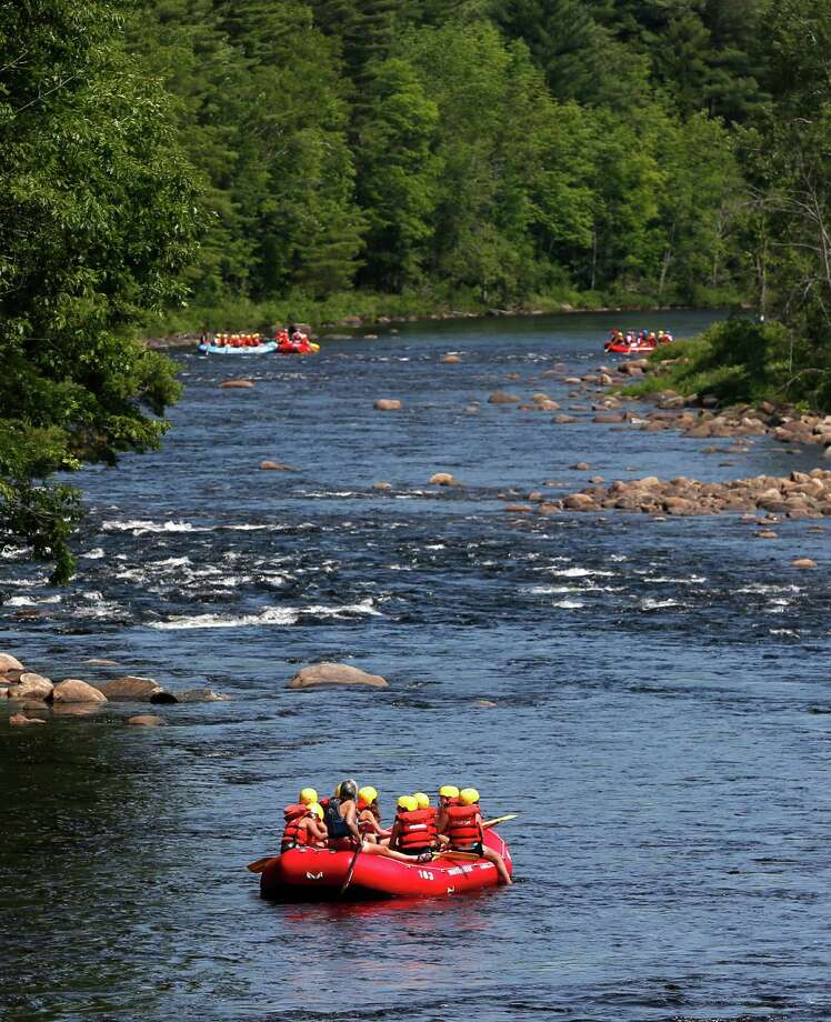 FILE - In this July 3, 2012 file photo, rafters navigate on the Hudson River in North River, N.Y. New York, unlike many states, the National Park Service and the U.S. Forest Service, regulates outdoor guides themselves, not the companies. That focus, say critics, allows companies to continue operating even when their guides have endangered any of the thousands of outdoors-lovers who engage their services. (AP Photo/Mike Groll, File) Photo: Mike Groll