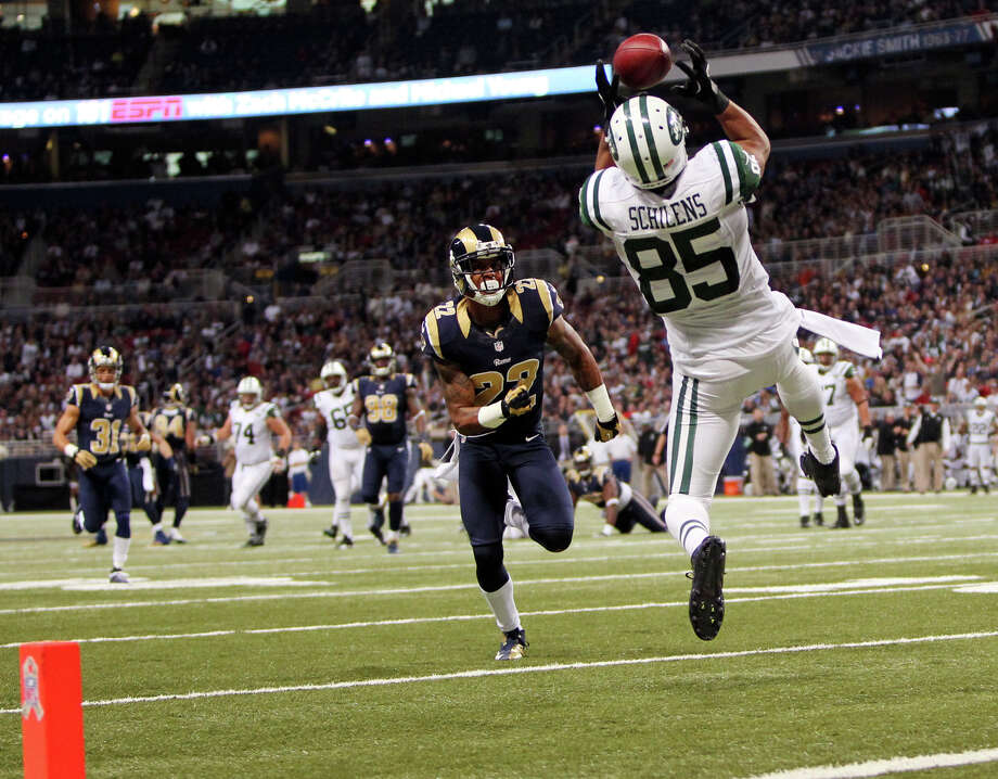 New York Jets wide receiver Chaz Schilens catches a 25-yard touchdown pass while being defended by St. Louis Rams cornerback Trumaine Johnson (22) during the second quarter of their NFL football game, Sunday, Nov. 18, 2012, in St. Louis. The Jets won 27-13. (AP Photo/St. Louis Post-Dispatch, Chris Lee)  EDWARDSVILLE INTELLIGENCER OUT; THE ALTON TELEGRAPH OUT Photo: Chris Lee