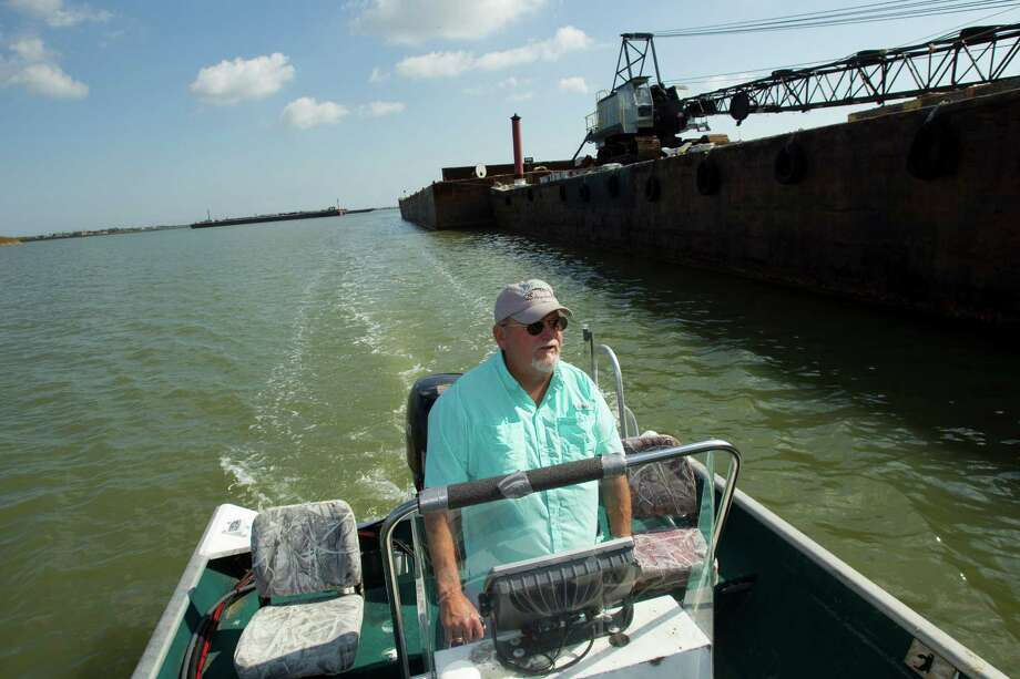 Steve Hoyland Sr., co-owner of the monthly SeaBreeze News, runs his boat through Dickinson Bayou. Concerned over fish kills, he hired a lab to test the quality of the water. Photo: Brett Coomer, Houston Chronicle / © 2012 Houston Chronicle