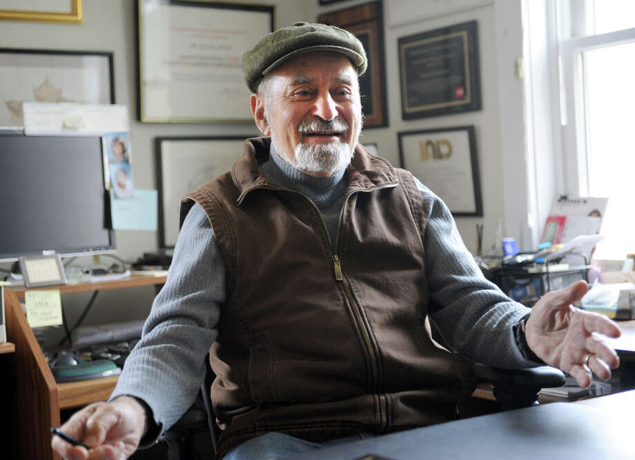 Howard Brandston sits in his home office and talks about light bulbs on Thursday, Nov. 15, 2012 in Claverack, N.Y. Brandston is a former adjunct professor at RPI's Lighting Institute who has mounted a one-man campaign to save the incandescent bulb. (Lori Van Buren / Times Union) Photo: Lori Van Buren