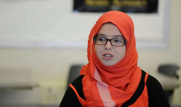 Student Lyna Benantar 14, from Algeria speaks to the Times Union about learning English as a second language for Arabic speaking students at Troy High School in Troy, N.Y. Nov 16, 2012.      (Skip Dickstein/Times Union) Photo: Skip Dickstein / 00020028A