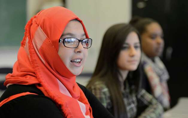 Student Lyna Benantar, 14 from Algeria speaks to the Times Union about learning English as a second language for Arabic speaking students at Troy High School in Troy, N.Y. Nov 16, 2012.      (Skip Dickstein/Times Union) Photo: Skip Dickstein / 00020028A
