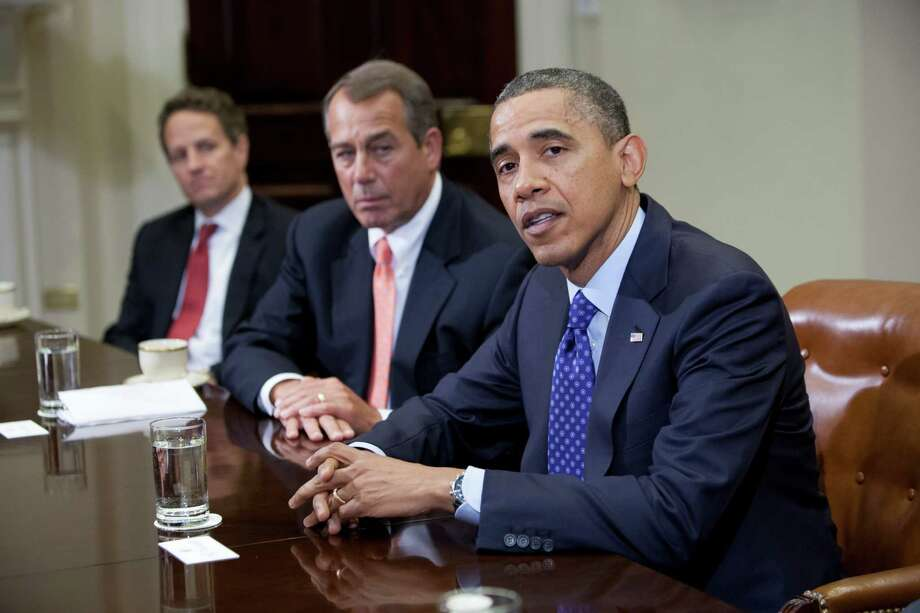 "US President Barack Obama speaks before Speaker John Boehner (R-OH) Secretary of the Treasury Timothy Geithner (3rdR) and other cabinet members during a meeting on November 16, 2012 in Washington,DC. Obama said Friday that Democrats and Republicans needed to make ""tough compromises"" in order to overcome divisions over deficit reduction and avoid the fiscal cliff. AFP PHOTO/TOBY JORRINTOBY JORRIN/AFP/Getty Images Photo: TOBY JORRIN"