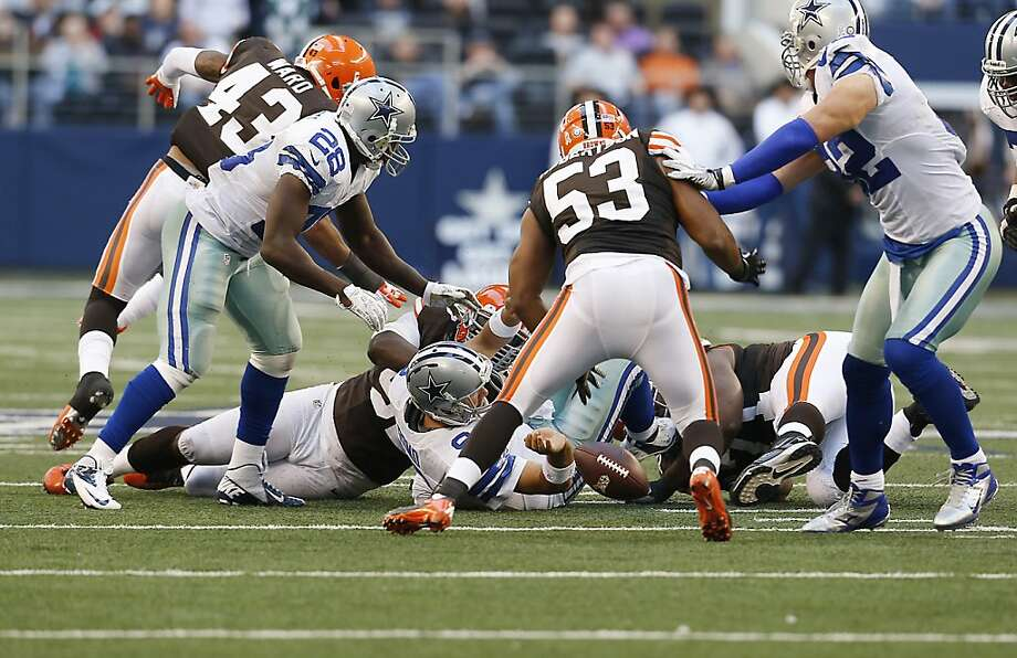 Dallas quarterback Tony Romo (on ground at center) fumbles, but the Cowboys overcame it. Photo: Sharon Ellman, Associated Press