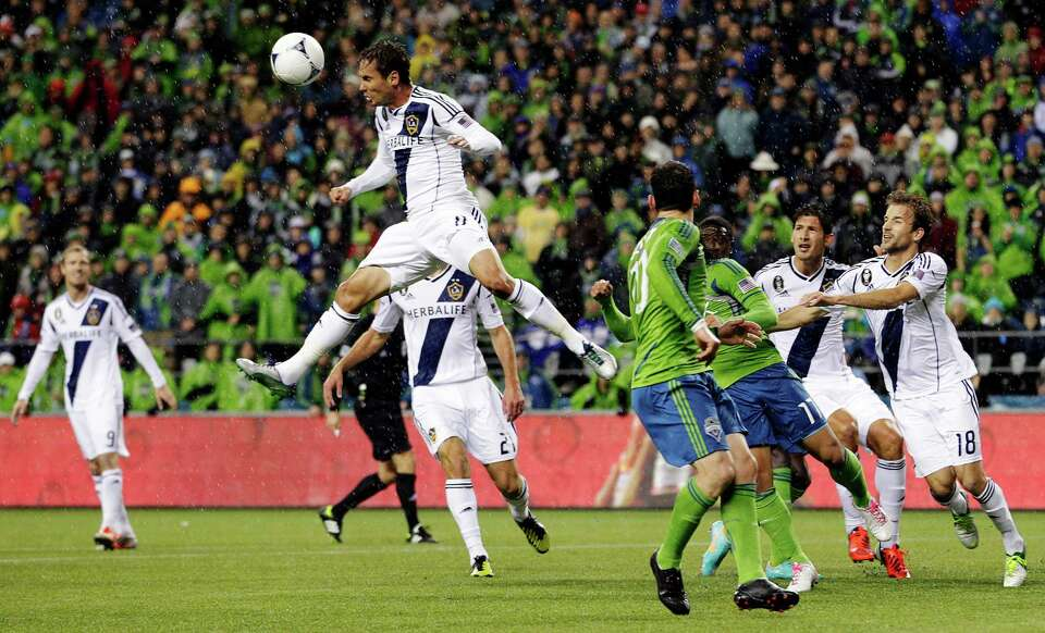 Los Angeles Galaxy's Marcelo Sarvas leaps to make a header in the first half of the MLS Western Conf