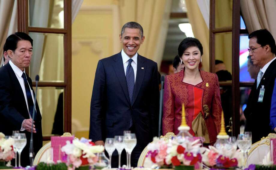 U.S. President Barack Obama, second left, and Thai Prime Minister Yingluck Shinawatra, second right, arrive for an official dinner at Government House in Bangkok, Thailand, Sunday, Nov. 18, 2012. (AP Photo/Carolyn Kaster) Photo: Carolyn Kaster