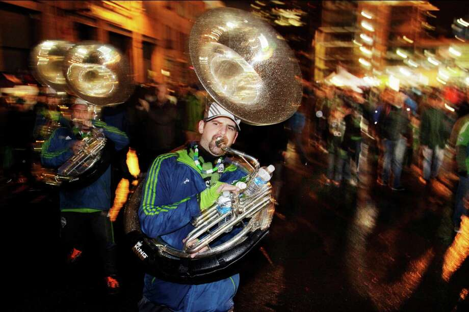 "Members of ""Sound Wave,"" the Seattle Sounders marching band, take part in the ""March to the Match"" prior to the MLS Western Conference championship soccer match between the Seattle Sounders and the Los Angeles Galaxy, Sunday, Nov. 18, 2012, in Seattle. (AP Photo/Ted S. Warren) Photo: Associated Press"