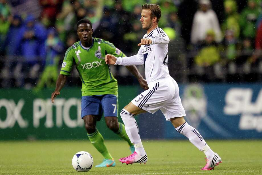 Seattle Sounders' Eddie Johnson (7) squares off against Los Angeles Galaxy's David Beckham, right, in the first half of the MLS Western Conference championship soccer match, Sunday, Nov. 18, 2012, in Seattle. (AP Photo/Ted S. Warren) Photo: Associated Press