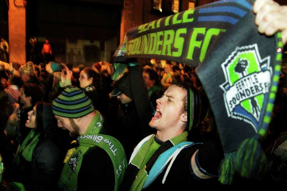 "Seattle Sounders fans take part in the ""March to the Match"" prior to the MLS Western Conference championship soccer match between the Seattle Sounders and the Los Angeles Galaxy, Sunday in Seattle. (AP Photo/Ted S. Warren) Photo: Associated Press"
