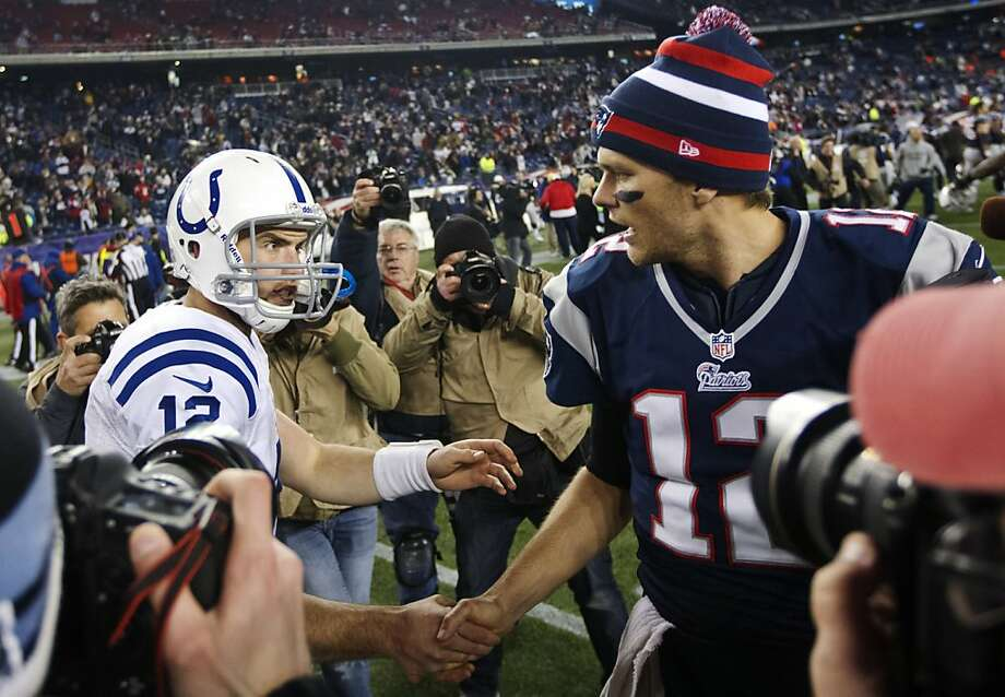 New England quarterback Tom Brady (right) greets Andrew Luck, his Indianapolis counterpart, after the Patriots' win. Photo: Matthew J. Lee, Associated Press