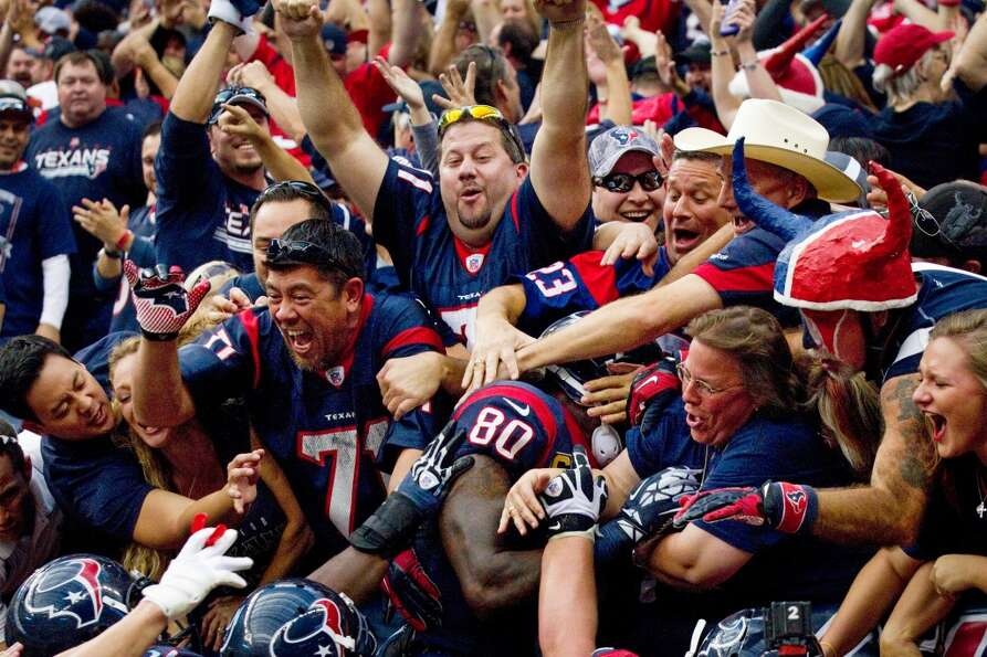 Houston Texans fans swarm Houston Texans wide receiver Andre Johnson (80) after he scored the game-w