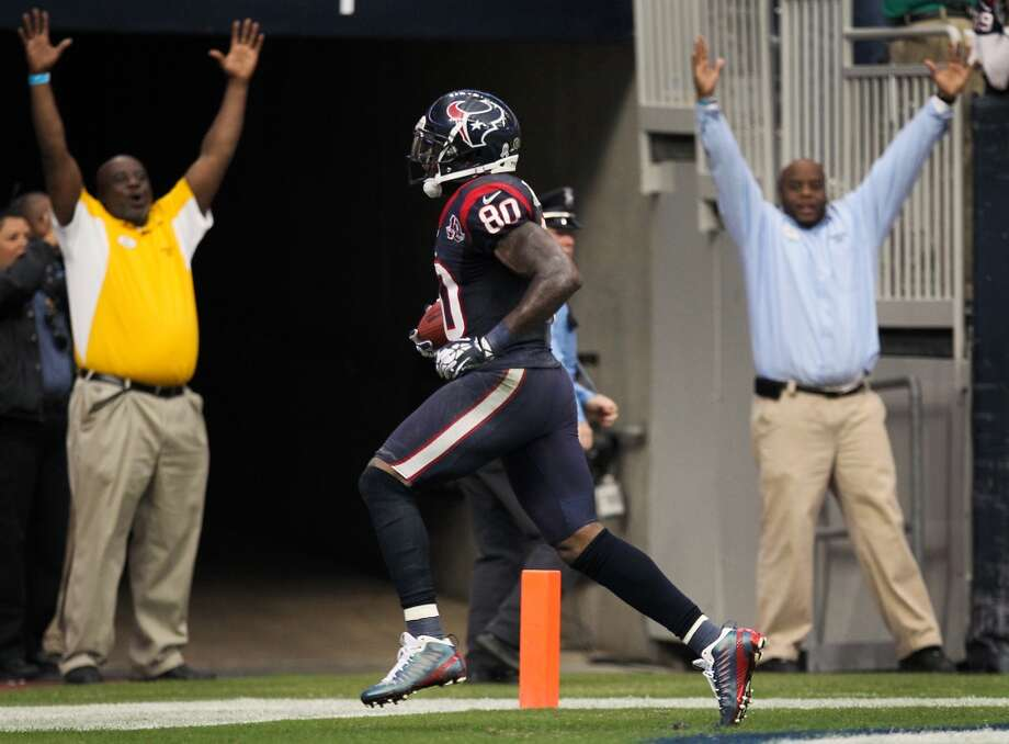 Texans wide receiver Andre Johnson (80) breaks away from the Jaguars defense for the game winning touch down. (Nick de la Torre / Houston Chronicle)