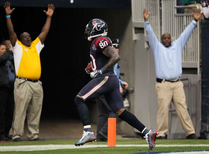 Texans wide receiver Andre Johnson (80) breaks away from the Jaguars defense for the game winning to