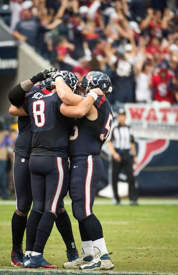 Texans quarterback Matt Schaub (8) celebrates with center Chris Myers (55) and tackle Duane Brown (76) after throwing a touchdown to Andre Johnson for an overtime victory over the Jaguars. (Smiley N. Pool / Houston Chronicle)