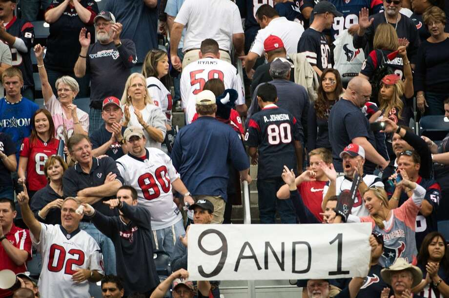 Texans fans celebrate an overtime victory over the Jacksonville Jaguars at Reliant Stadium. (Smiley N. Pool / Houston Chronicle)