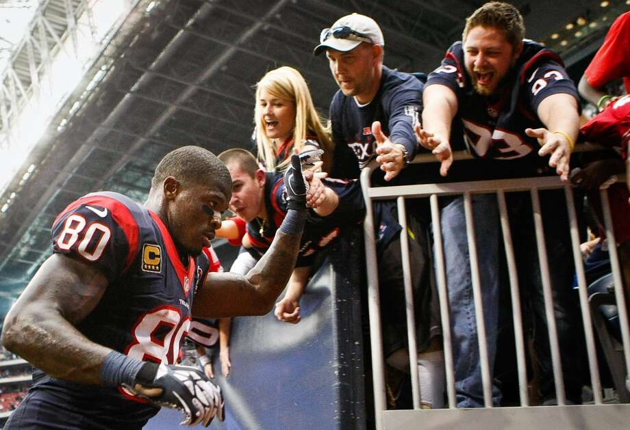 Texans wide receiver Andre Johnson (80) gives fans high fives after the Texans beat the Jaguars 43-37, (Nick de la Torre / Houston Chronicle)