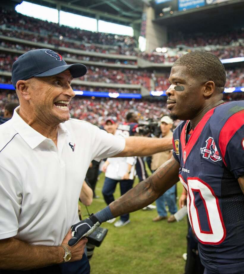 Texans wide receiver Andre Johnson celebrates with assistant head coach/defensive line Bill Kollar after the Texans 43-37 overtime victory. Kollar was hospitalized in Chicago to undergo tests for a blood clot that was discovered before the 13-6 victory over the Bears. (Smiley N. Pool / Houston Chronicle)