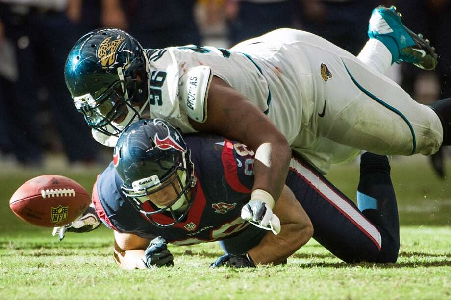 Jacksonville Jaguars defensive tackle Terrance Knighton (96) knocks a pass away from Houston Texans tight end Garrett Graham (88) during overtime. (Smiley N. Pool / Houston Chronicle)