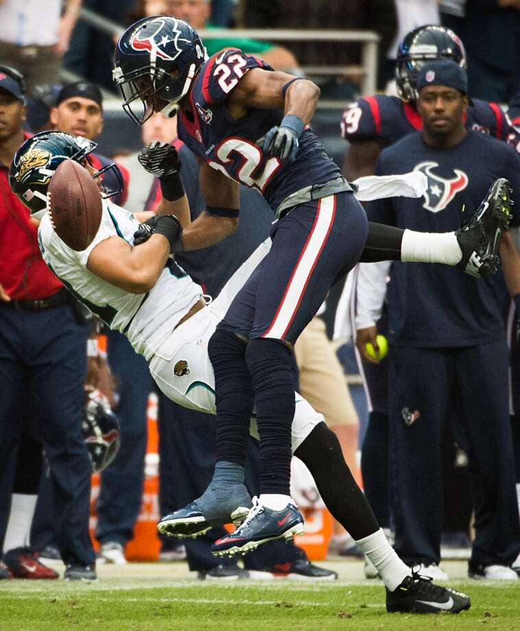 Texans defensive back Alan Ball (22) breaks up a pass intended for Jaguars wide receiver Laurent Robinson (81) during overtime. (Smiley N. Pool / Houston Chronicle)