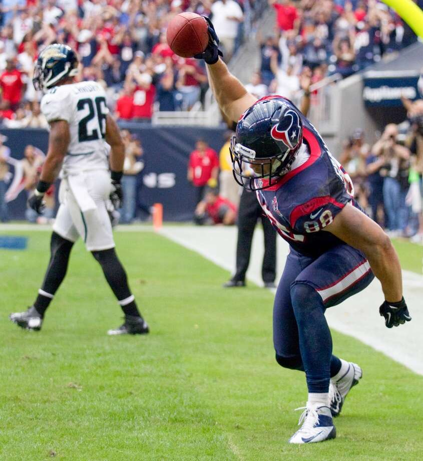 Texans tight end Garrett Graham (88) spikes the football after beating Jaguars strong safety Dawan Landry (26) for a 5-yard touchdown reception to tie the game during the fourth quarter. (Brett Coomer / Houston Chronicle)