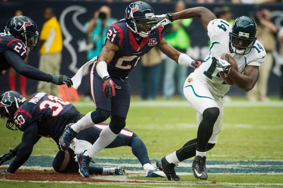 Jaguars wide receiver Justin Blackmon (14) breaks away from Houston Texans defensive backs Brice McCain (21), Danieal Manning (38) and Quintin Demps (27) on an 81-yard touchdown during the fourth quarter. (Smiley N. Pool / Houston Chronicle)