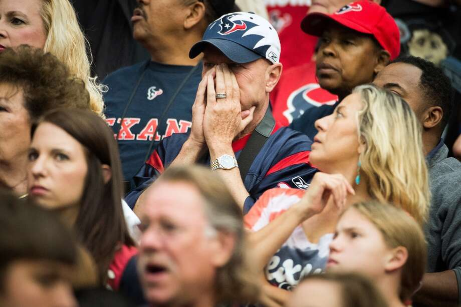 Texans fans experience some tense moments as the game heads to overtime tied 37-37. (Smiley N. Pool / Houston Chronicle)