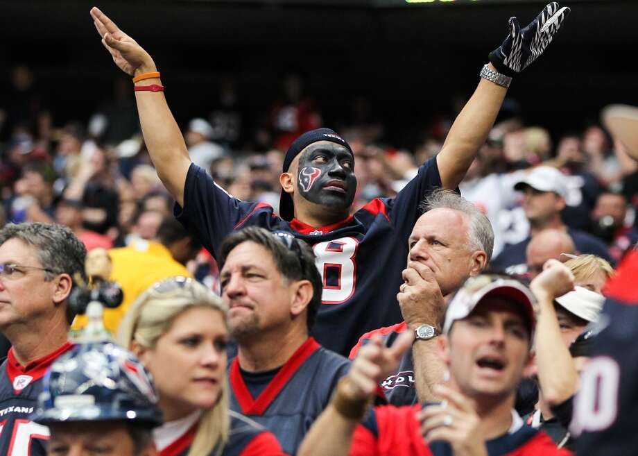 A Texans fan tries to quiet the crowd during the fourth quarter. (Karen Warren / Houston Chronicle)