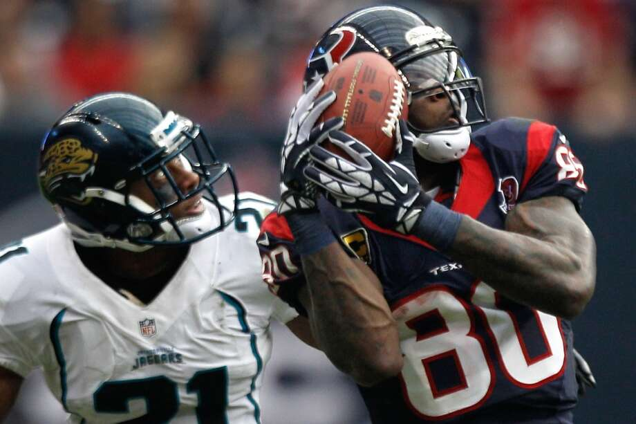 Texans wide receiver Andre Johnson (80) beats Jaguars cornerback Derek Cox (21) for a reception during the fourth quarter. (Brett Coomer / Houston Chronicle)