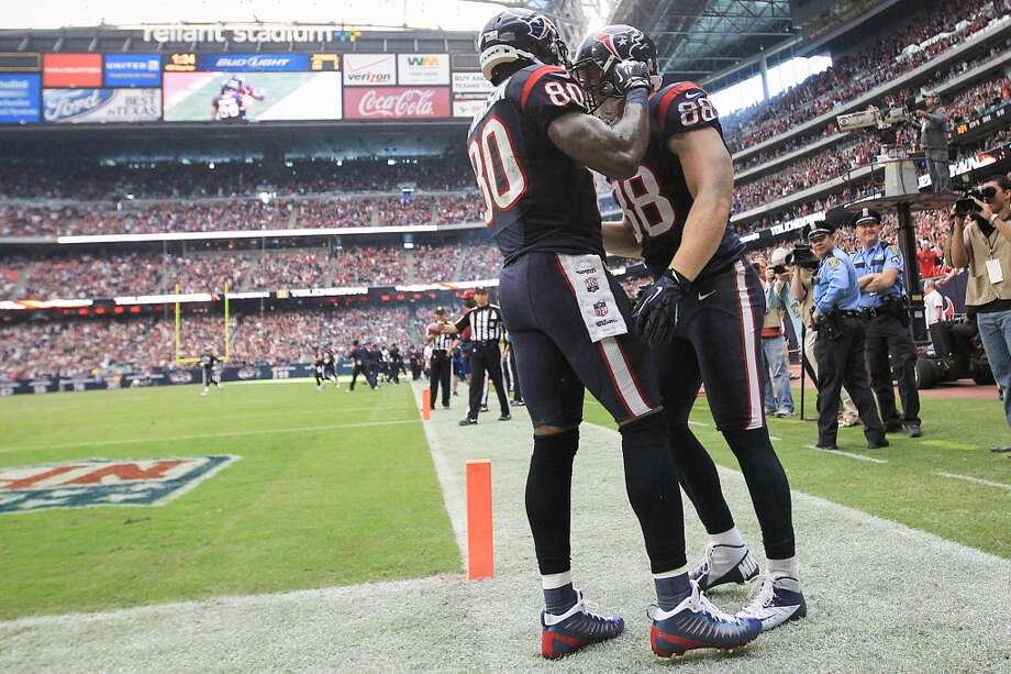 Texans tight end Garrett Graham (88) celebrates one of his touchdowns with wide receiver Andre Johnson (80) during the fourth quarter. (Karen Warren / Houston Chronicle)