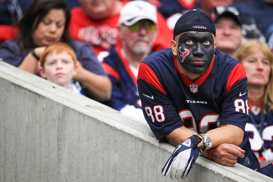 A Texans fan watches the game during the fourth quarter. (Karen Warren / Houston Chronicle)