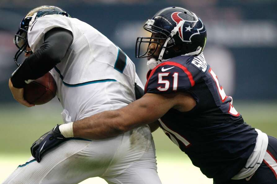 Texans linebacker Darryl Sharpton tackles Jacksonville Jaguars quarterback Chad Henne as he scramble