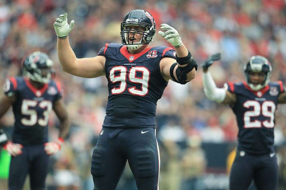 Texans defensive end J.J. Watt (99) and the rest of the defense try to get the crowd fired up during the fourth quarter. (Karen Warren / Houston Chronicle)