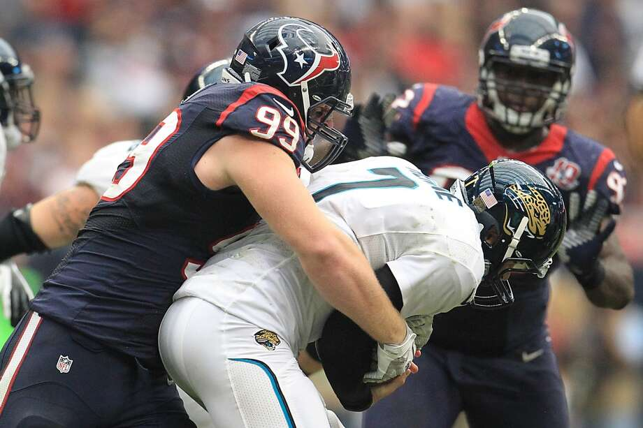 Texans defensive end J.J. Watt (99) sacks Jacksonville Jaguars quarterback Chad Henne (7) during the fourth quarter. (Karen Warren / Houston Chronicle)