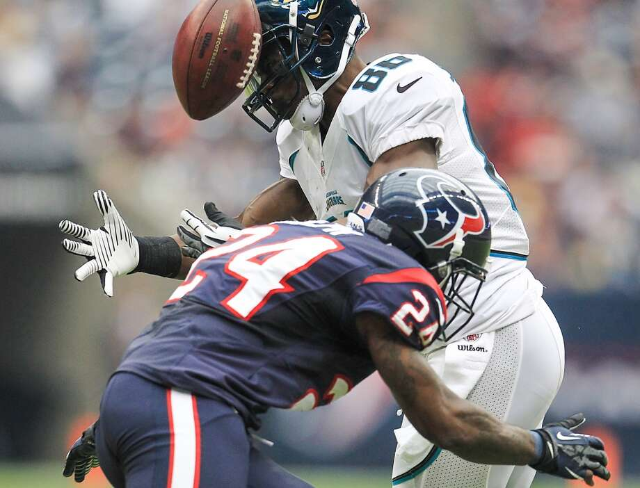 Texans cornerback Johnathan Joseph (24) breaks up a pass intended for Jaguars wide receiver Micheal Spurlock (86) during the third quarter. (Karen Warren / Houston Chronicle)