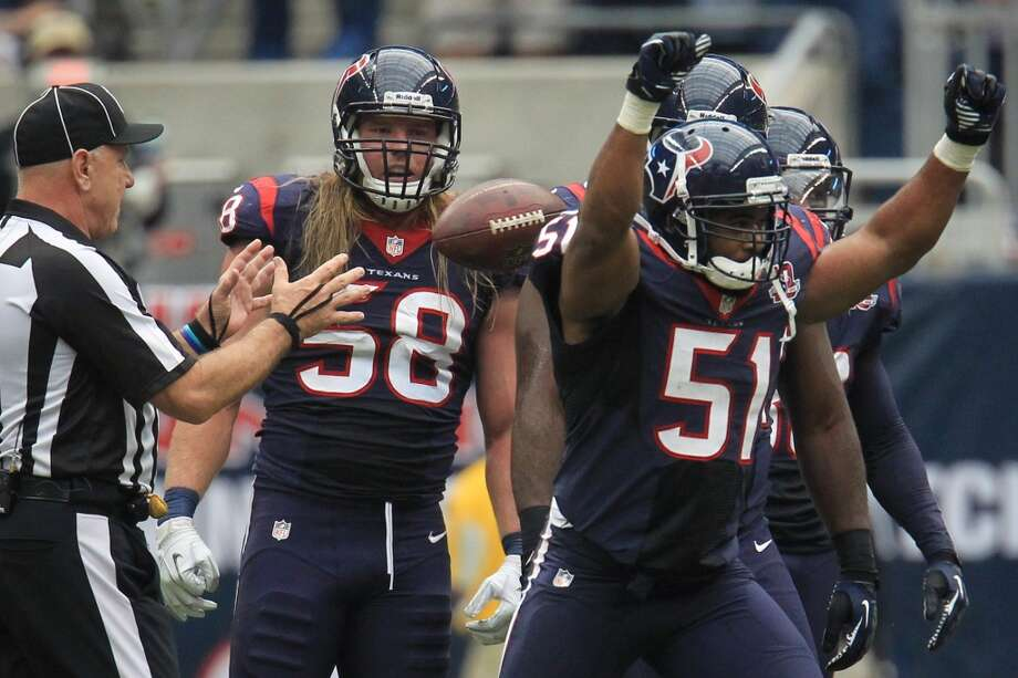 Texans linebacker Darryl Sharpton (51) celebrates after making a defensive stop against the Jaguars during the second quarter. (Karen Warren / Houston Chronicle)