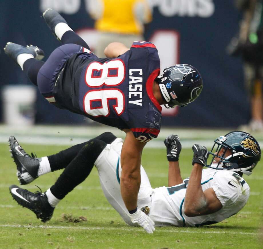 Texans fullback James Casey (86) is upended by Jaguars cornerback Derek Cox (21) during the first quarter. (Brett Coomer / Houston Chronicle)