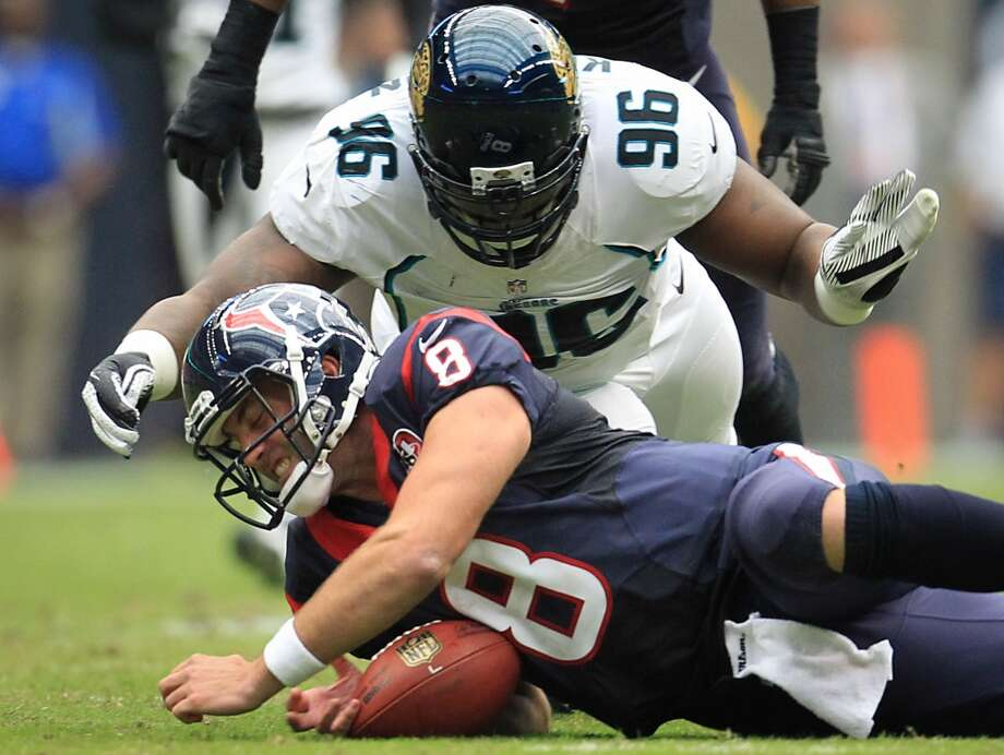 Texans quarterback Matt Schaub recovers his own fumble as Jacksonville defensive tackle Terrance Knighton (96) dives in after a hit by Jaguars defensive tackle C.J. Mosley during the first quarter. (Karen Warren / Houston Chronicle)