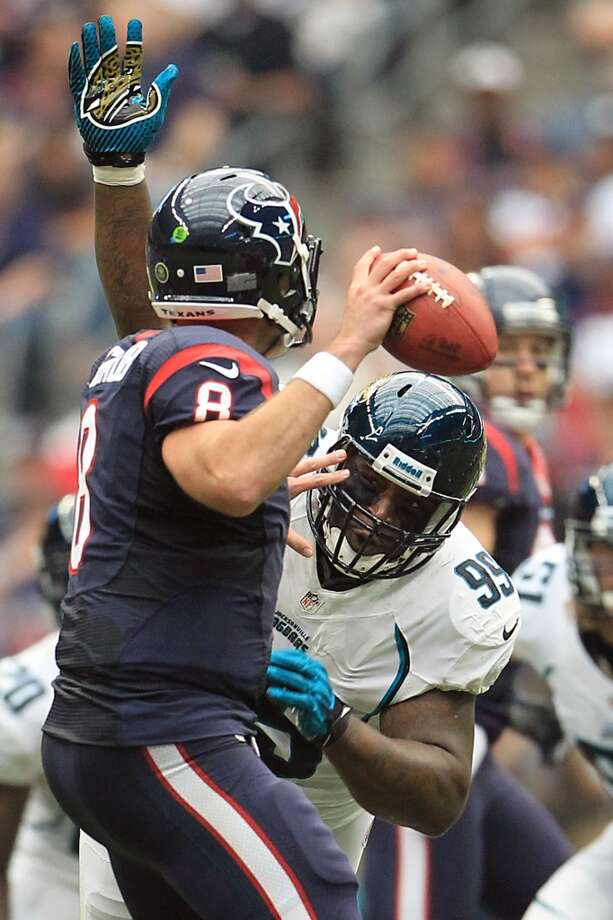 Jaguars defensive tackle C.J. Mosley (99) puts pressure on Texans quarterback Matt Schaub (8) forcing a fumble that the Texans recovered during the first quarter. (Karen Warren / Houston Chronicle)