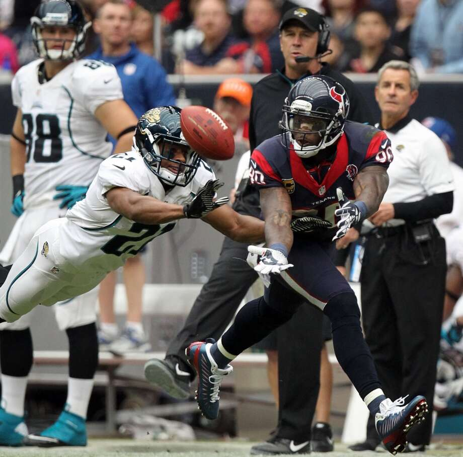 Jaguars cornerback Derek Cox (21) breaks up a pass intended for Texans wide receiver Andre Johnson (80) during the first quarter. (Nick de la Torre / Houston Chronicle)