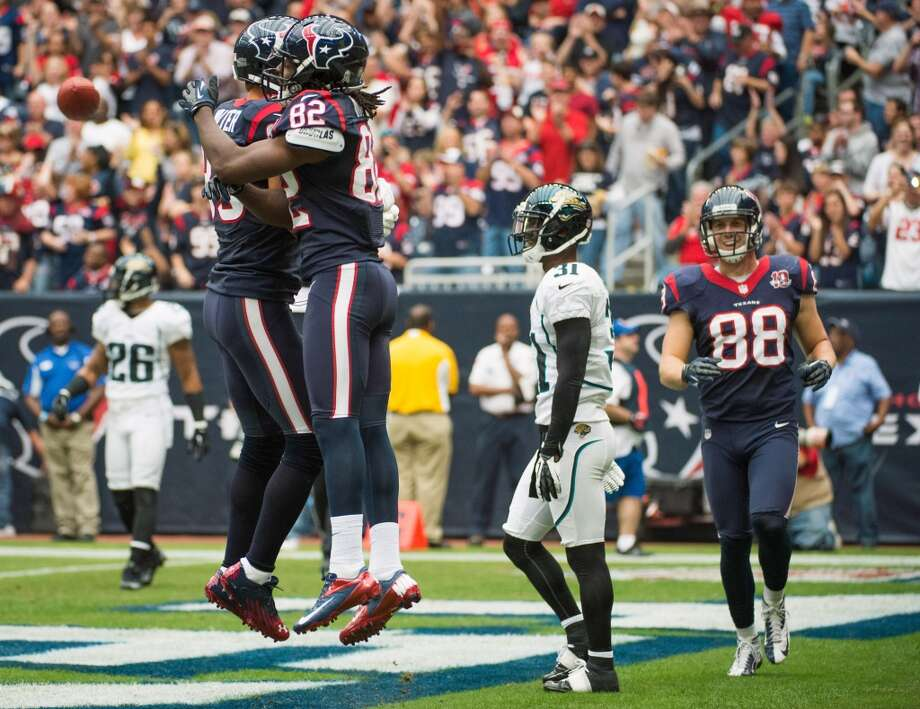 Texans wide receiver Keshawn Martin (82) celebrates with wide receiver Kevin Walter (83) during the first quarter after catching a touchdown pass. (Smiley N. Pool / Houston Chronicle)